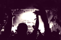 Crowd of audience with hands raised at a music festival Royalty Free Stock Image