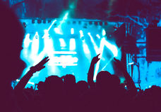 Crowd of audience with hands raised at a music festival Royalty Free Stock Images