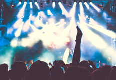 Crowd of audience with hands raised at a music festival Stock Photography
