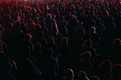 Crowd background at music festival. Crowd in a colorful lights of open air festival. silhouettes of night party Stock Photos