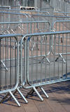 Crowd Barriers detail. Metal crowd control barriers placed outside a large venue in preparation for use to ensure orderly entrance and exit by crowds Royalty Free Stock Photography