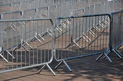 Crowd Barriers detail. Metal crowd control barriers placed outside a large venue in preparation for use to ensure orderly entrance and exit by crowds Stock Photo