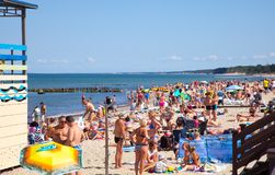 A crowd of bathers in Zelenogradsk beach located on the Baltic Sea coast, Russia. Zelenogradsk, Russia - August 17, 2017: A crowd of bathers in Zelenogradsk Stock Photo