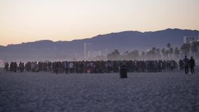 Crowd at the beach during sunset Royalty Free Stock Images