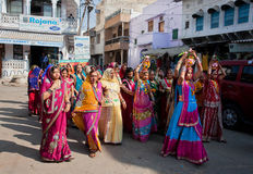 Crowd of beautiful dressed women walking to the wedding celebration Royalty Free Stock Photography