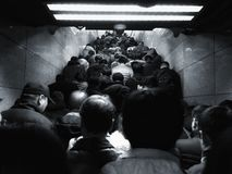 The crowd on the Beijing subway in the morning rush hour. People jostled each other in the subway from a narrow passageway Royalty Free Stock Images