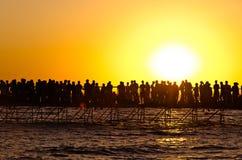Crowd bidding farewell to the sun Stock Photo