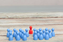 Crowd of blue pawns, with red pawn Royalty Free Stock Images