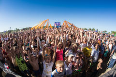 Crowd of blurred people. Cosmos Village, Almaty Province, Kazakhstan - 16 August 2015: The festival of ethnic music Forey, a lot of people gathers on this Stock Photography