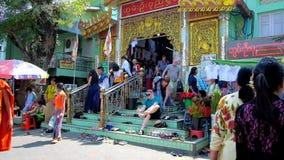 Crowd at Buddhist Temple, Sagaing, Myanmar. SAGAING, MYANMAR - FEBRUARY 21, 2018: The crowded entrance to Image house of Soon Oo Pon Nya Shin Pagoda, people take stock footage