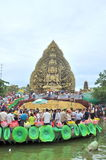 Crowd of Buddhists are offering incense to Buddha with thousand hands and thousand eyes in the Suoi Tien park in Saigon Royalty Free Stock Photos