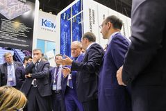 A crowd of business people at the company stand. Stock Photography