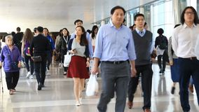 People walk through the shopping mall in Hong Kong stock video