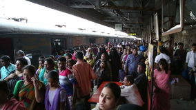 Crowd at a busy train station in Mumbai. MUMBAI, INDIA - 16 JANUARY 2015: Crowd at a busy train station in Mumbai stock video