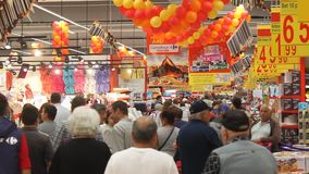 Crowd of buyers in hypermarket Carrefour Royalty Free Stock Images