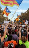 Demonstrators for freedom and against political prisoners in barcelona vertical. The crowd carry estelada flags, pro separatist catalan flag, during a Royalty Free Stock Image