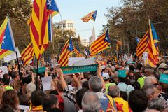 Demonstrators for freedom in barcelona and estelada flags. The crowd carry estelada flags, pro separatist catalan flag, and raise their hands during a Stock Photo