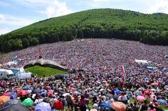 Crowd of Catholic pilgrims gathering to celebrate the Pentecost. CSIKSOMLYO, ROMANIA - JUNE 7: Crowds of Hungarian pilgrims gather to celebrate the Pentecost and royalty free stock photos