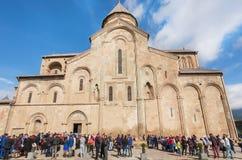 Crowd celebrating the City Day past the historical christian Svetitskhoveli Cathedral. UNESCO World Heritage Site. Stock Photos