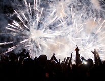 Crowd celebrating the New Year with fireworks Royalty Free Stock Photography