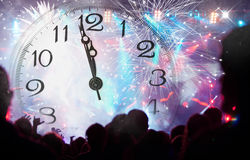 Crowd celebrating the New year with fireworks Royalty Free Stock Photo