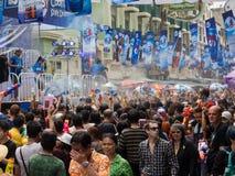 Crowd Celebrating Songkran 2014 in Bangkok, Thailand. Crowd celebrating the traditional Thai New Year, Songkran, on Khao San Road in Bangkok, Thailand Stock Photos