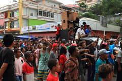 Crowd on celebration. Crowd of young Papuan people - kids, boys, girls, men and women in occasion of celebration of first entry of protestant missionaries Ottow Stock Images