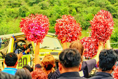 Crowd & Cheer leaders. Crowd and Cheer Leaders cheering for the Offroader to win for a `Annual Offroad Carnival` event in Pune, India Royalty Free Stock Images
