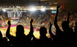 Crowd cheering at basketball stadium. Silhoutte of crowd cheering at basketball stadium Royalty Free Stock Photo
