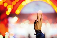 Crowd cheering at concert, Silhouette of a hand of fans Royalty Free Stock Image