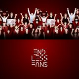 Crowd of cheering fans in red colors Royalty Free Stock Photo