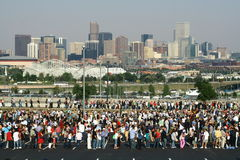Crowd and city skyline Royalty Free Stock Photos