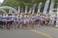 Crowd of Color Run Racers Take Off Running Royalty Free Stock Photos