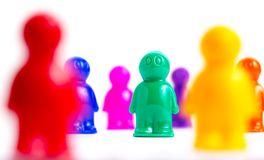 Crowd of colorful toy people Royalty Free Stock Photo