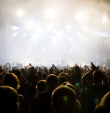 Crowd at concert. People having fun at concert and stage in colorful smoke Stock Photo