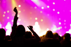 Crowd at a concert. Audience raising hands up royalty free stock image