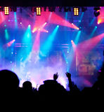 Crowd at concert. Live concert cheering crowd waving, scene lights and party atmosphere Stock Image