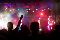 Crowd at concert. Live concert cheering crowd waving, scene lights and party atmosphere Royalty Free Stock Image