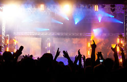 Crowd at concert. Live concert cheering crowd waving, scene lights and party atmosphere Royalty Free Stock Photo
