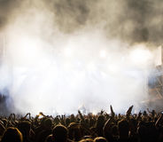 Crowd at concert. Silhouettes in front of stage Royalty Free Stock Photography
