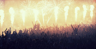 Crowd at concert and blurred stage lights Royalty Free Stock Photography