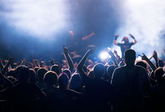Crowd at concert and blurred stage lights Royalty Free Stock Images