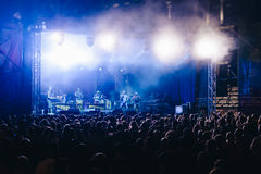 Crowd at concert and blurred stage lights Stock Image