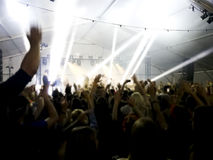 Crowd at concert - Cheering crowd in front of bright colorful stage lights. Festival Royalty Free Stock Photos