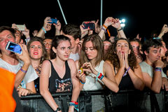 Crowd in a concert at FIB Festival. BENICASSIM, SPAIN - JUL 18: Crowd in a concert at FIB Festival on July 18, 2015 in Benicassim, Spain Stock Photos