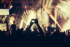 Crowd at a concert with hands up stock images