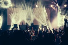 Crowd at a concert with hands up royalty free stock images