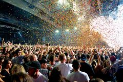 Crowd in a concert, while throwing confetti from the stage at Sonar Festival royalty free stock photo