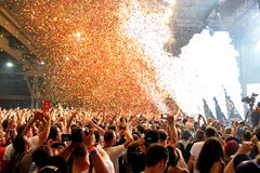 Crowd in a concert, while throwing confetti from the stage at Sonar Festival Royalty Free Stock Photos