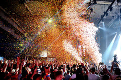 Crowd in a concert, while throwing confetti from the stage at Sonar Festival Stock Photo